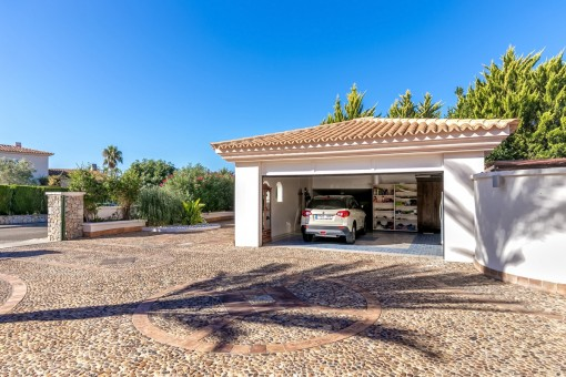 Large driveway with the two-car garage
