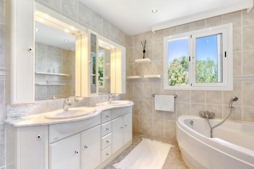Beautiful master bathroom with bath tub