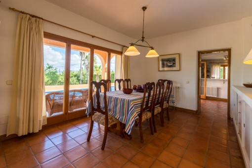 Dining area with views of the pool