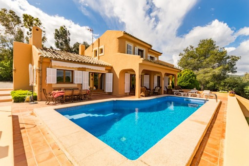 Sunny pool area with terrace