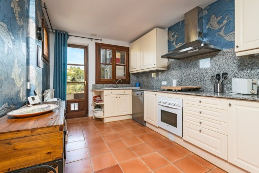 Separated and fully equipped kitchen