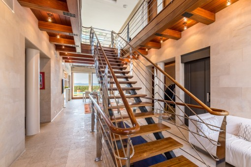 Staircase leads from the entrance to the living area