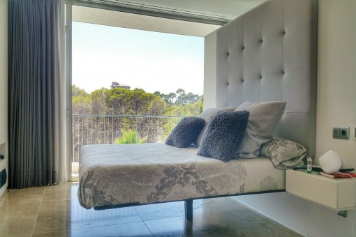 One of three bedrooms with views of the surrounding
