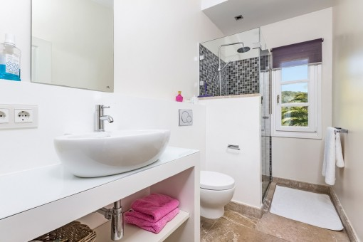 Bathroom with shower and garden views