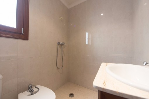 Bright bathroom with spacious shower