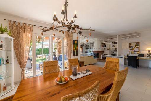 Open living and dining area with access to terrace