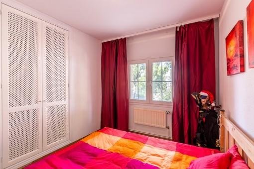 Beautiful bedroom with built-in wardrobe