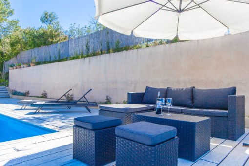 Lounge area beside the pool