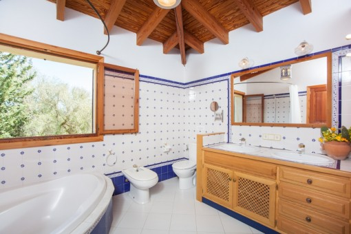 Mediterranean bathroom with bath tub
