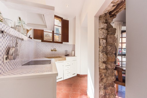 Open kitchen with natural stone door