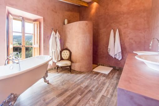 Bright bathroom with bathtub and shower