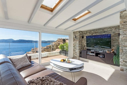 Lounge area on the partly covered terrace with sea views