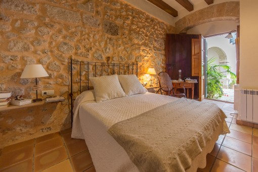 Cosy bedroom with natural stone walls