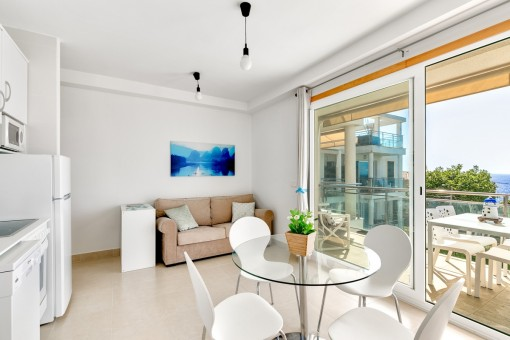 Living and dining area with fully equipped kitchen and direct access to the terrace