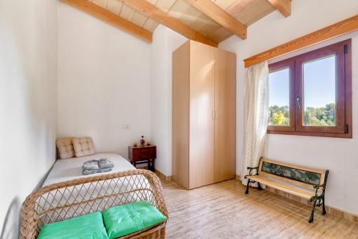 Single bedroom with garden views
