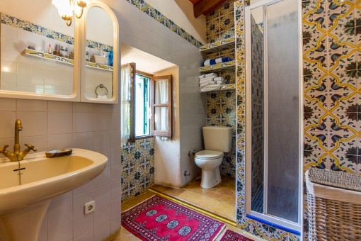 Bathroom with shower and traditional tiles