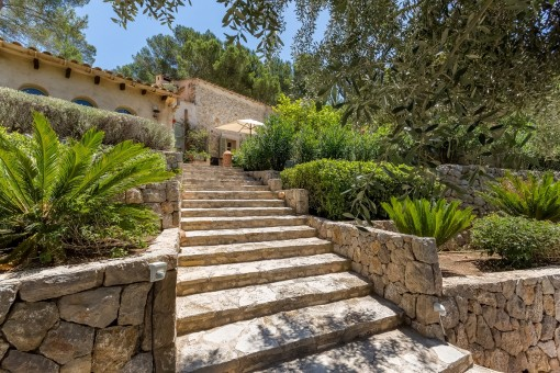 Stone staircase leads to the property