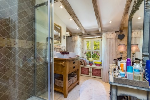 Charming bathroom with shower and mirror