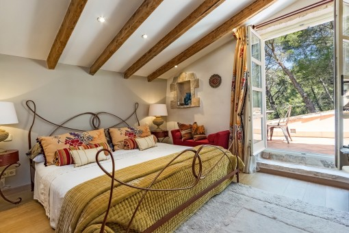 Master bedroom with access to a terrace