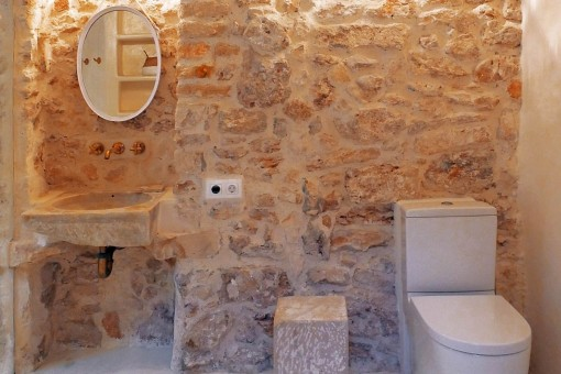 Bathroom with natural stone wall
