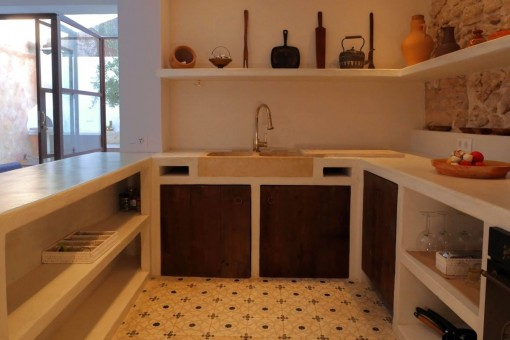 Kitchen, constructed and finished in white polished cement