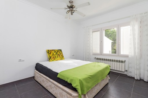 Guest bedroom with a fan for warm summer nights