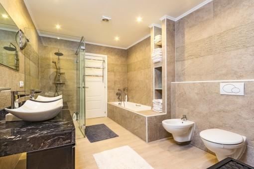 Master bathroom with bathub and shower