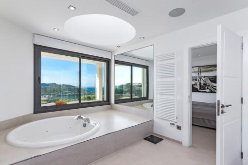 Master bathroom with bathub and sea views