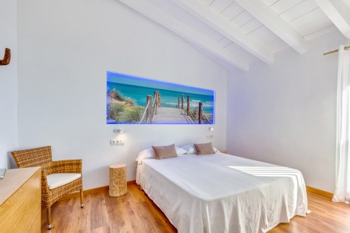 Friendly bedroom with wood-beamed ceiling