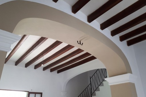 Traditional arch and wooden ceiling beams