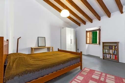 Bedroom with wooden ceiling beams
