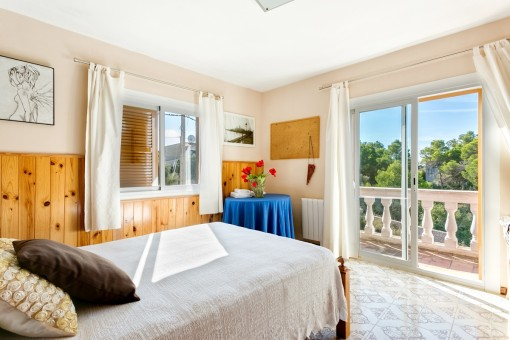Sunny bedroom with balcony access