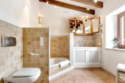 Mediterranean bathroom with bathtub and natural light