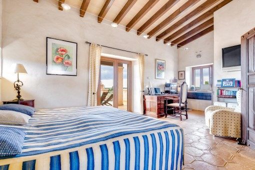 Spacious master bedroom with access to the terrace