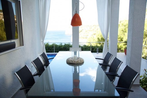 Bright dining area with sea views