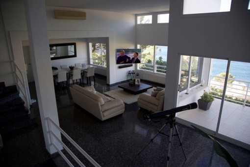 Open living and dining area with sea views