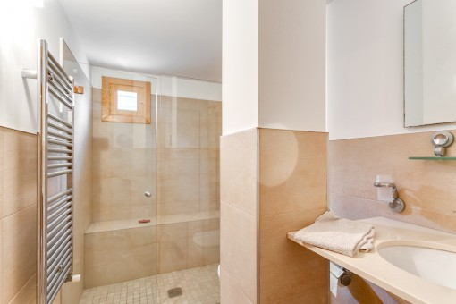 Bathroom with walk-in shower and heating