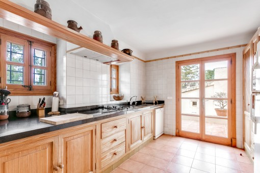 Light-flooded kitchen with terrace access