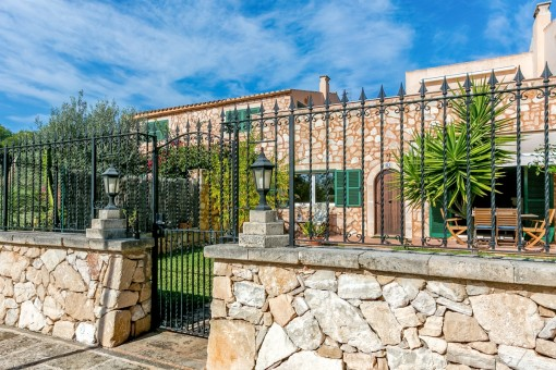 Exterior view of this charming apartment with stone facade