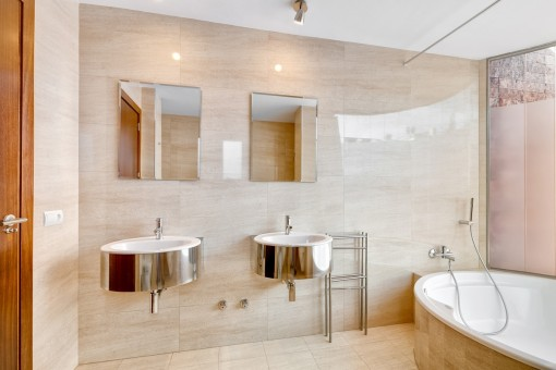 Noble bathroom with bathtub and natural light