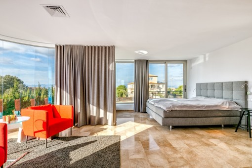 Capacious master bedroom with fantastic glass façade