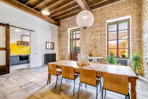 Spacious dining area with natural stone wall