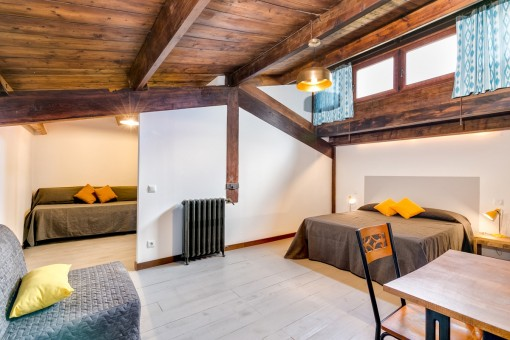 Large bedroom with eccentric wooden ceiling