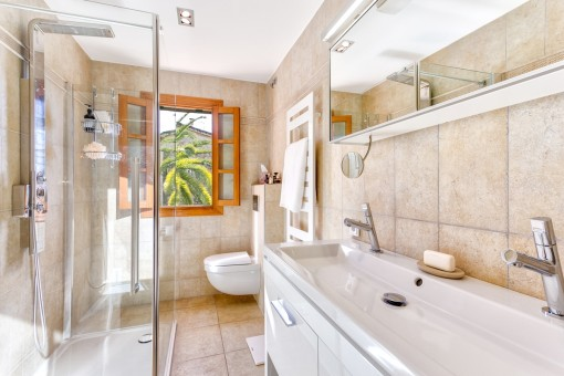 Main bathroom with a walk-in shower