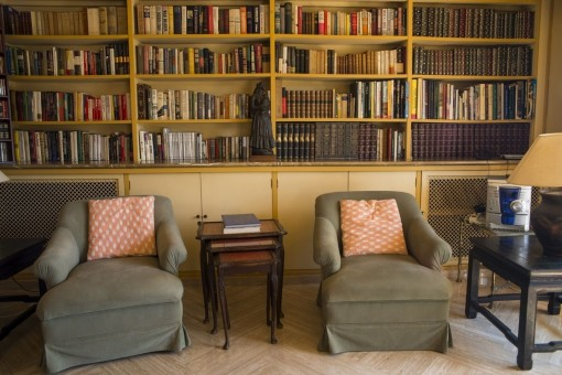 Small library with arm chairs