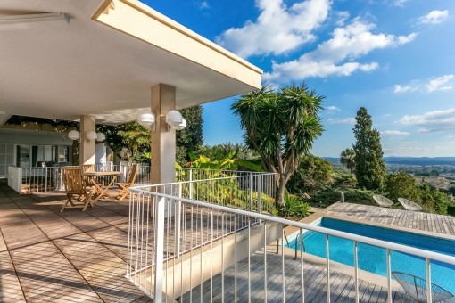 The villa offers several seating areas on the veranda