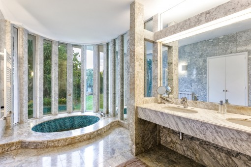The master bathroom is designed with marble