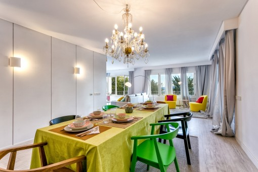 Long dinner table with a stylish chandelier