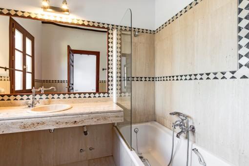 Second bathroom with shower-bathtub