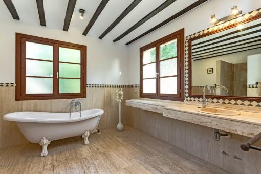 Noble master bathroom with bathtub